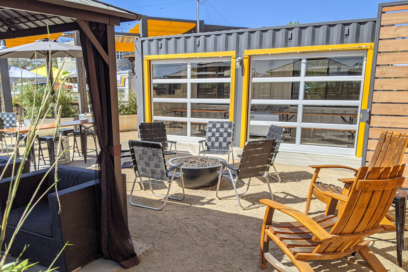 The Garage, Fire Pits, and Porch reservation areas at The Backyard on Thirteenth