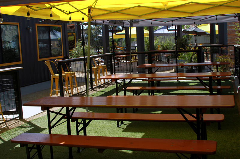 Reservable beer garden tables on the lawn area at The Backyard on Thirteenth in Paso Robles