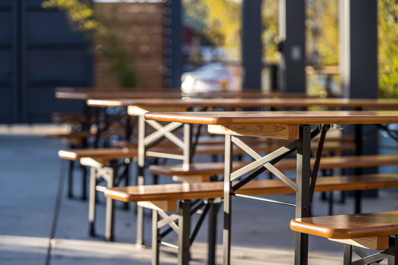 Beer garden tables available for reservation at The Backyard on Thirteenth beer garden